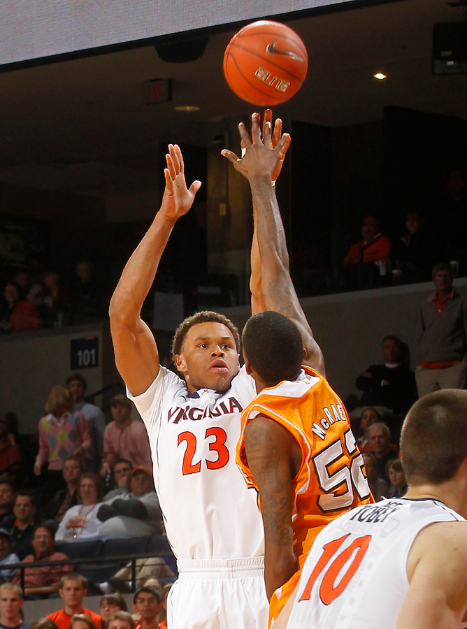 Virginia guard Justin Anderson (23) shoots over Tennessee guard Jordan McRae (52) during the game Wednesday in Charlottesville, VA. Virginia defeated Tennessee 46-38.