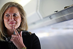 Ann Romney, wife of Republican Presidential candidate Mitt Romney (R-MA), listens to him speak with reporters on their plane before it takes off from Columbus International Airport in Columbus, Ohio on Tuesday, March 06, 2012. (Photo by Yana Paskova for The New York Times)<br /> <br /> Assignment ID: 30122237A