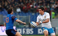Rugby, Torneo Sei Nazioni: Italia vs Francia. Roma, stadio Olimpico, 15 marzo 2015.<br /> Italy's Luca Morisi, right, is challenged by France's Camille Lopez during the Six Nations championship rugby match between Italy and France at Rome's Olympic stadium, 15 March 2015.<br /> UPDATE IMAGES PRESS/Riccardo De Luca