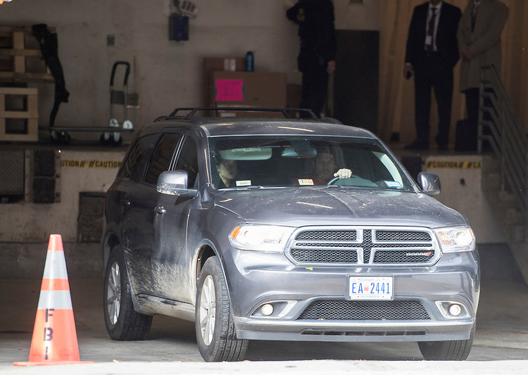 UNITED STATES - OCTOBER 30: A car said to be transporting former Donald Trump campaign manager Paul Manafort leaves the FBI Washington Field Office after Manafort turned himself in to the FBI on Monday, Oct. 30, 2017. (Photo By Bill Clark/CQ Roll Call)
