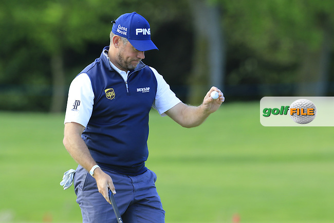 Lee Westwood (ENG) finishes on the 18th green during Thursday's Round 1 of the 2016 Dubai Duty Free Irish Open hosted by Rory Foundation held at the K Club, Straffan, Co.Kildare, Ireland. 19th May 2016.<br /> Picture: Eoin Clarke | Golffile<br /> <br /> <br /> All photos usage must carry mandatory copyright credit (&copy; Golffile | Eoin Clarke)