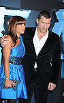 """HOLLYWOOD, CA. - December 16: Sam Worthington and guest attend the Los Angeles premiere of """"Avatar"""" at Grauman's Chinese Theatre on December 16, 2009 in Hollywood, California."""