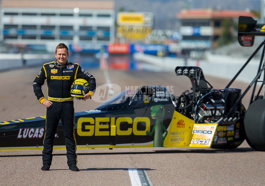 Feb 19, 2015; Chandler, AZ, USA; NHRA top fuel driver Richie Crampton poses for a portrait prior to the Carquest Nationals at Wild Horse Pass Motorsports Park. Mandatory Credit: Mark J. Rebilas-