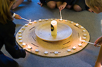 Lighting candles in the school Chapel.  Roman Catholic State secondary school.