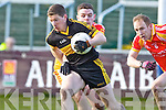 Kieran O'Leary, Dr. Crokes in action against Aidan Walsh, in the All Ireland Senior Club Semi Final at Portlaoise on Saturday.