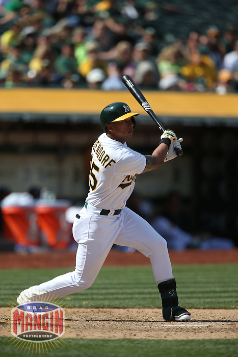 OAKLAND, CA - APRIL 9:  Tyler Ladendorf #25 of the Oakland Athletics bats against the Texas Rangers during the game at O.co Coliseum on Thursday, April 9, 2015 in Oakland, California. Photo by Brad Mangin