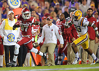 11/14/15<br /> Arkansas Democrat-Gazette/STEPHEN B. THORNTON<br /> Arkansas' Dominique Reed pulls away from a defenders to score Arkansas' first TD in the first   quarter of their game Saturday in Baton Rouge, La.