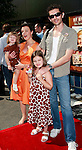 US actress Debi Mazar poses with husband Gabriele Corcos and daughters Evelyn (standing) and Giulia as she arrives at the world premiere of 'Kit Kittredge: An American Girl' at the Grove in Los Angeles, California on 14 June 2008. The film is based on the American Girl doll line and centers on Kit Kittredge, a young woman who grows up in the early years of the Great Depression.