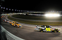 Nov. 16, 2008; Homestead, FL, USA; NASCAR Sprint Cup Series driver Jimmie Johnson (48) leads Matt Kenseth (17) during the Ford 400 at Homestead Miami Speedway. Mandatory Credit: Mark J. Rebilas-