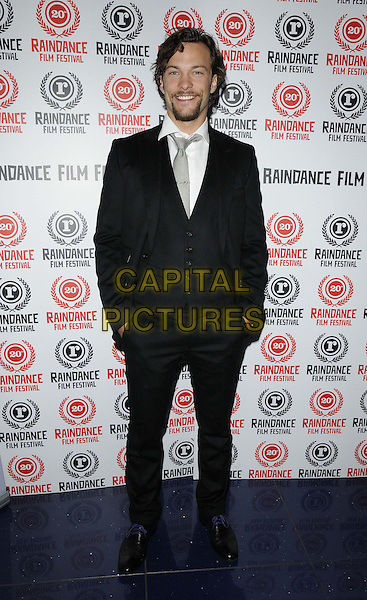 Kyle Schmid.attended the 'Dark Hearts' official screening, Raindance Film Festival, Apollo cinema, Regent St., London, England, 29th September 2012..full length black suit white shirt grey gray tie  waistcoat hands in pockets .CAP/CAN.©Can Nguyen/Capital Pictures.