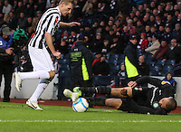 Kelvin Wilson on the ball watched by Gary Teale in the St Mirren v Celtic Scottish Communities League Cup Semi Final match played at Hampden Park, Glasgow on 27.1.13.