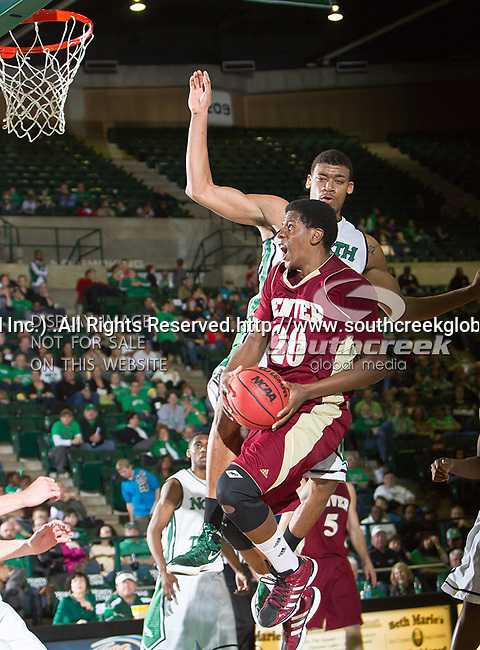 Denver Pioneers forward Royce O'Neale (20) and North Texas Mean Green forward Tony Mitchell (13) in action during the game between the Denver Pioneers and the University of North Texas Mean Green at the North Texas Coliseum,the Super Pit, in Denton, Texas. UNT defeated Denver 75 to 74 in overtime.