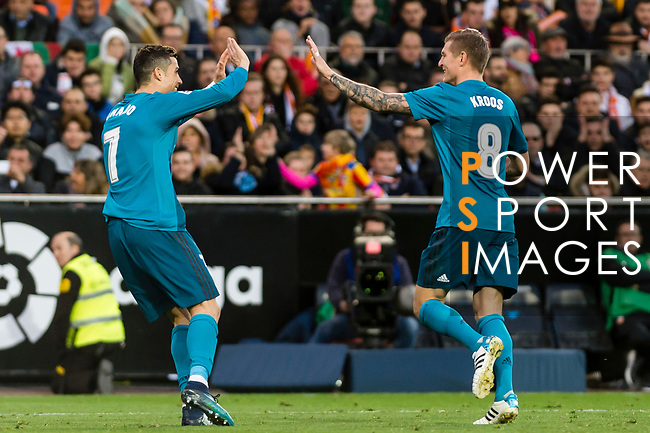 Toni Kroos of Real Madrid (R) celebrates after scoring his goal with Cristiano Ronaldo of Real Madrid (L) during the La Liga 2017-18 match between Valencia CF and Real Madrid at Estadio de Mestalla  on 27 January 2018 in Valencia, Spain. Photo by Maria Jose Segovia Carmona / Power Sport Images