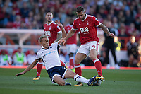 George Saville of Millwall tackles Daryl Murphy of Nottingham Forest during the Sky Bet Championship match between Nottingham Forest and Millwall at the City Ground, Nottingham, England on 4 August 2017. Photo by James Williamson / PRiME Media Images.