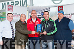 Tom Randles and Weeshie Fogarty presents the April Sports star of the Month award to Paul Nagle in Randles garage on Friday include are Sean MacMonagle left and Padraig Hartnett right