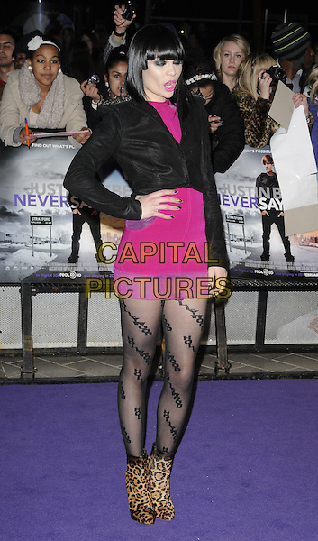 JESSIE J (Jessica Ellen Cornish).The UK Premiere of Justin Bieber: Never Say Never, Cineworld, 02 Arena, London, England..February 16th, 2011.full length black jacket pink dress hand on hip studs studs silver shoulder pads shoulders patterned tights ankle boots leopard animal print mouth open eyes closed funny.CAP/CAN.©Can Nguyen/Capital Pictures.