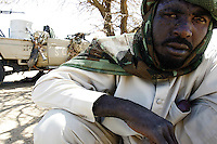 an SLA ( Sudan liberation officer) shows his battle wounds at a forewding base in north darfur on Nov 2004