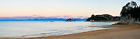 Panoramic Photo of Beautiful Kaiteriteri Beach at Sunset, Tasman Region, South Island, New Zealand. This panoramic photo shows beautiful Kaiteriteri beach at sunset. Kaiteriteri is a stunning beach with golden sands in the Tasman Region of South Island, New Zealand.
