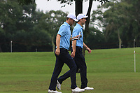 Bernd Wiesberger (Europe) and Ross Fisher (Europe) walking up the 7th fairway during the Saturday Foursomes of the Eurasia Cup at Glenmarie Golf and Country Club on the 13th January 2018.<br /> Picture:  Thos Caffrey / www.golffile.ie