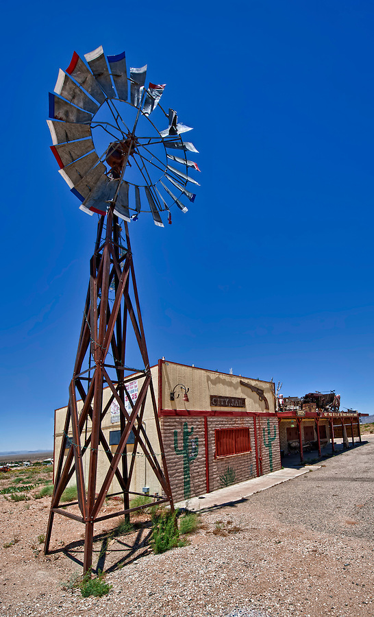 View of desolated bar with windmill in Route 66