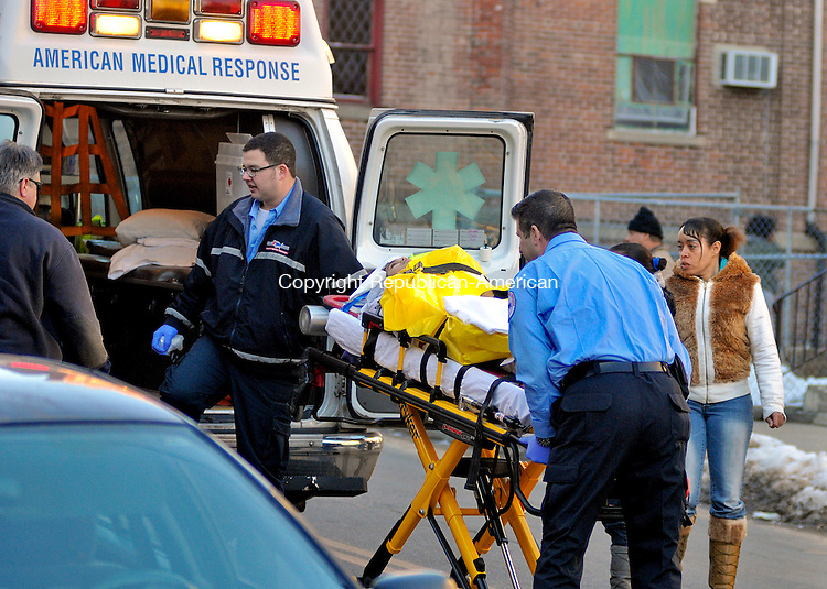 WATERBURY, CT 18 JANUARY 2013- 011813JS01-- Emergency prepare to transport an 8-year-old boy after he was struck by a car after getting off the bus on Cooke Street in Waterbury on Friday. .Jim Shannon Republican American .