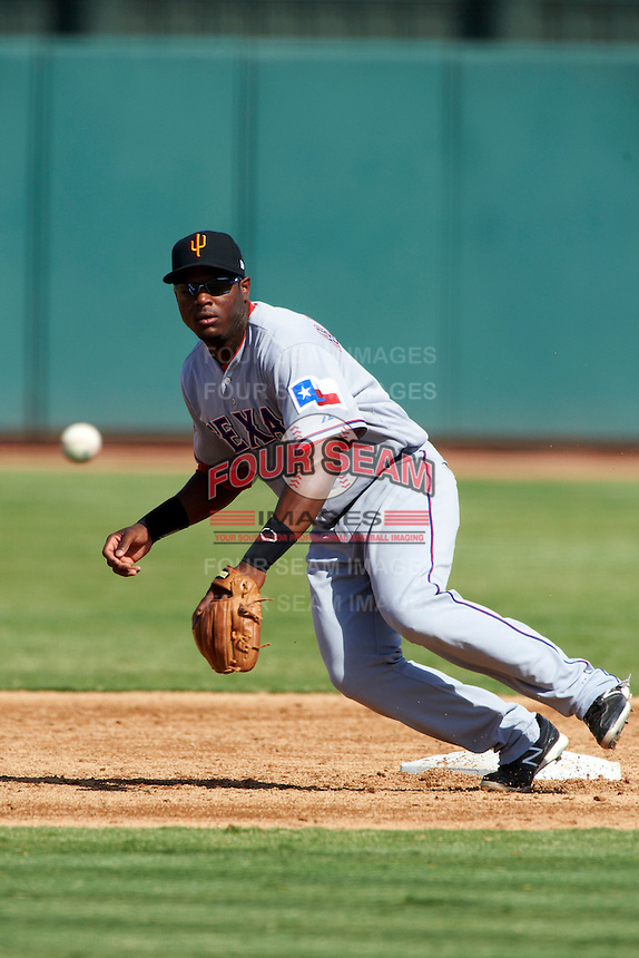 Surprise Saguaros second baseman Hanser Alberto #7, of the Texas Rangers organization, during an Arizona Fall League game against the Phoenix Desert Dogs at Phoenix Municipal Stadium on October 18, 2012 in Phoenix, Arizona.  The game was called after eleven innings with a 2-2 tie.  (Mike Janes/Four Seam Images)
