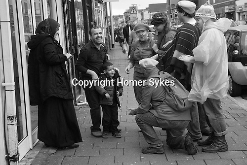 Made in Roath Arts Festival 2014. Cardiff Wales. The Visitors, Bread and Noses entertaining local family.