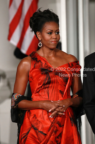 United States first lady Michelle Obama waits for President Hu Jintao of China to arrive for a State dinner at the White House, Wednesday, January 19, 2011 in Washington, DC. Obama and Hu met in the Oval Office earlier in the day. .Credit: Win McNamee / Pool via CNP