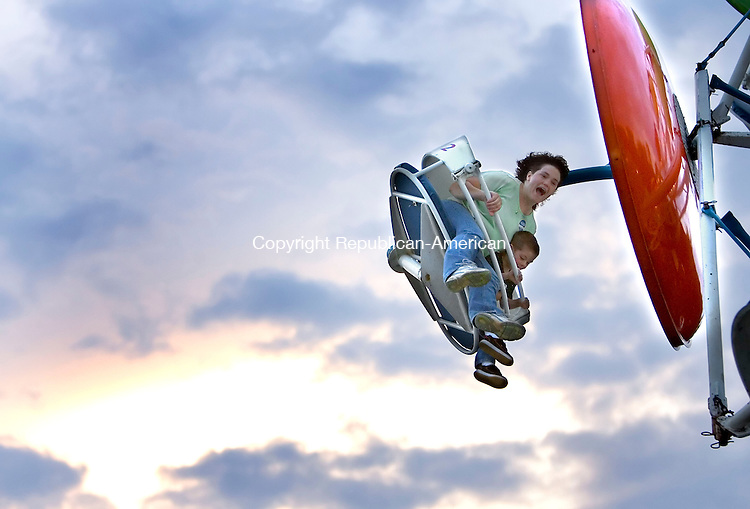 OXFORD, CT--30 JUNE 2006 -063006JS07-Shari Stempert of Wolcott and son Patrick, 4, take a ride on the Paratrooper on Friday during the Quaker Farms Volunteer Fire Company's carnival held at Quaker Farms School in Oxford. The four-day carnival runs through today.-- Jim Shannon Republican-American