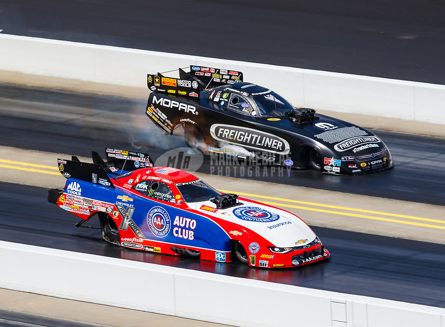 Sep 17, 2017; Concord, NC, USA; NHRA funny car driver Robert Hight (near) defeats Matt Hagan during the Carolina Nationals at zMax Dragway. Mandatory Credit: Mark J. Rebilas-USA TODAY Sports