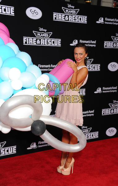 HOLLYWOOD, CA- JULY 15: Dancer Karina Smirnoff arrives at the Los Angeles premiere of Disney's 'Planes: Fire &amp; Rescue' at the El Capitan Theatre on July 15, 2014 in Hollywood, California.<br /> CAP/ROT/TM<br /> &copy;Tony Michaels/Roth Stock/Capital Pictures