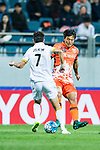 Jeju United Midfielder Lee Chandong (R) fights for the ball with Adelaide United Midfielder Kim Jaesung (L) during the AFC Champions League 2017 Group Stage - Group H match between Jeju United FC (KOR) vs Adelaide United (AUS) at the Jeju World Cup Stadium on 11 April 2017 in Jeju, South Korea. Photo by Marcio Rodrigo Machado / Power Sport Images