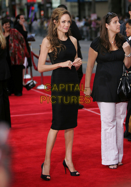 ANGELINA JOLIE .The Warner Brothers Pictures L.A. Premiere of Ocean's Thirteen held at The Grauman's Chinese Theatre in Hollywood, California, USA..June 5th, 2007             .full length dress black christian louboutin shoes peep toe peeptoe .CAP/DVS.©Debbie VanStory/Capital Pictures