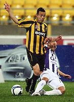 Perth's Adriano Pellegrino tackles Diego Walsh during the A-League football match between Wellington Phoenix and Perth Glory at Westpac Stadium, Wellington, New Zealand on Sunday, 16 August 2009. Photo: Dave Lintott / lintottphoto.co.nz