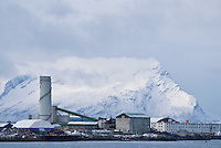 Waterfront factory and snow covered mountains, Bodoe, Norway