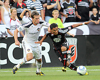Andy Najar #14 of D.C. United pushes past Todd Dunivant #2 of the Los Angeles Galaxy during an MLS match at RFK Stadium on July 18 2010, in Washington D.C. Galaxy won 2-1.