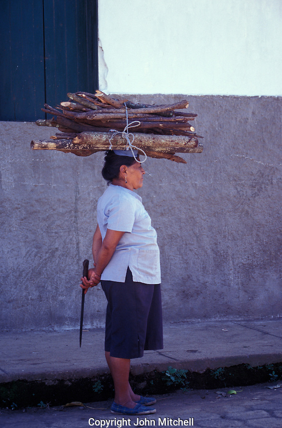 Middle-aged woman balancing firewood on her head in Catarina, Pueblos Bloncos, Nicaragua