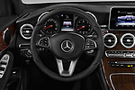 Car pictures of steering wheel view of a 2017 Mercedes Benz GLC-Coupe 300-4MATIC 5 Door SUV Steering Wheel