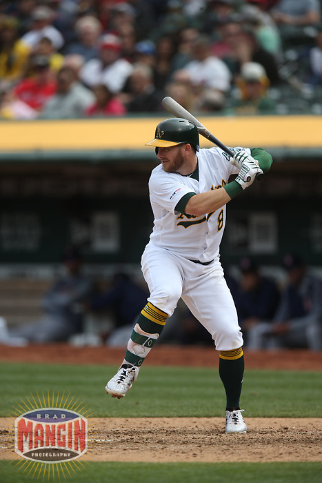 OAKLAND, CA - APRIL 4:  Robbie Grossman #8 of the Oakland Athletics bats against the Boston Red Sox during the game at the Oakland Coliseum on Thursday, April 4, 2019 in Oakland, California. (Photo by Brad Mangin)