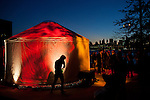 Yurts glowed from within as the sun set over the Manhattan skyline.