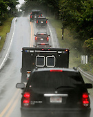 The motorcade carrying United States President Barack Obama, travels down Edgartown West Tisbury Road in Edgartown, Massachusetts on the island of Martha's Vineyard on August 12, 2013.  President Obama and his family are spending the week on the island for their summer vacation.  <br /> Credit: Matthew Healey / Pool via CNP