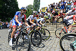 The peloton including Thibaut Pinot (FRA) Groupama-FDJ and Daryl Impey (RSA) Mitchelton-Scott climb the Muur in Geraardsbergen during Stage 1 of the 2019 Tour de France running 194.5km from Brussels to Brussels, Belgium. 6th July 2019.<br /> Picture: Colin Flockton | Cyclefile<br /> All photos usage must carry mandatory copyright credit (© Cyclefile | Colin Flockton)