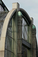 Tropical Rainforest Glasshouse (formerly Le Jardin d'Hiver or Winter Gardens), 1936, René Berger, Jardin des Plantes, Museum National d'Histoire Naturelle, Paris, France. View from the side of the top of the main Art Deco style entrance consisting of pillars in luminescent glass paste by Auguste Labouret and wrought iron decoration made by Raymond Subes.