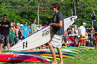 North Shore, Oahu, Hawaii (December 5, 2013) Greg Long (USA). -- The 29th annual Quiksilver In Memory of Eddie Aikau, the original one-day big wave invitational surfing event, officially opened its holding period with the traditional Hawaiian Opening Ceremony at Waimea Bay today, December 5, at 3pm. Event Invitees and Alternates joined with the Aikau Family and Hawaiian Kahu Billy Mitchell to honor Aikau and welcome the winter big wave period. The Hokule'a, the replica of a traditional Hawaiian voyaging canoe anchored in The Bay during the ceremony with the crew coming ashore and joining the circle. Photo: joliphotos.com