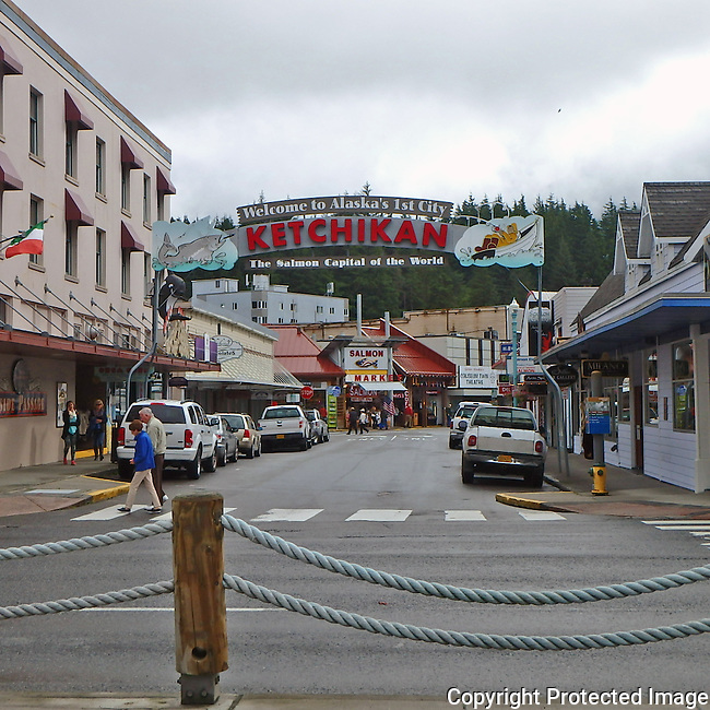 main commercial street of Ketchikan, Alaska, salmon fishing capitol, welcome to Ketchikan sign over street