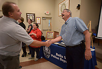 NWA Democrat-Gazette/BEN GOFF @NWABENGOFF<br /> Ken Farmer (right), Bella Vista Police Chief, talks with citizens Friday, May 19, 2017, during a retirement ceremony and reception for Farmer at American Legion Post  341 in Bella Vista. Farmer began his law enforcement career in 1978 with the Benton County Sheriff's Office, working in the sheriff's office Bella Vista Division. Farmer started as a captain with the Bella Vista Police Department after the city incorporated in 2007, and became the department's chief in October 2009. James Graves has been hired as incoming chief, and will take over full responsibility as chief on June 1.