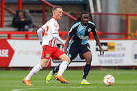 Tom Conlon of Stevenage and Marcus Bean of Wycombe Wanderers in action during the Sky Bet League 2 match between Stevenage and Wycombe Wanderers at the Lamex Stadium, Stevenage, England on 17 October 2015. Photo by PRiME Media Images.