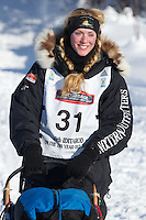 Kristy Berington on Long Lake at the Re-Start of the 2012 Iditarod Sled Dog Race