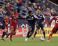 New England Revolution forward Kenny Mansally (7) dribbles in traffic. In a Major League Soccer (MLS) match, Real Salt Lake defeated the New England Revolution, 2-0, at Gillette Stadium on April 9, 2011.