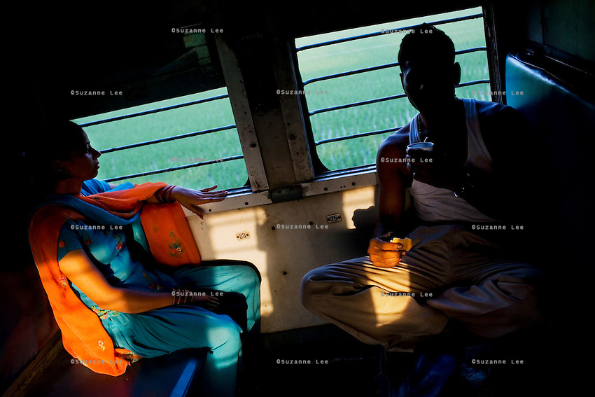 Train passengers enjoy a breakfast of biscuits, cake and milk tea on the Himsagar Express 6318 going from Jammu Tawi station to Kanyakumari on 7th July 2009.. .6318 / Himsagar Express, India's longest single train journey, spanning 3720 kms, going from the mountains (Hima) to the seas (Sagar), from Jammu and Kashmir state of the Indian Himalayas to Kanyakumari, which is the southern most tip of India...Photo by Suzanne Lee / for The National